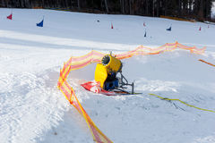 Snow cannon on empty fenced track for skiers in a ski-resort. On a sunny day Royalty Free Stock Photos