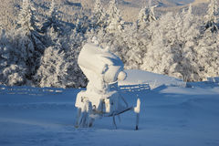 Snow Cannon. A snow cannon or snow gun covered in snow and ice on top of the Clabucet ski slope in Predeal, Romania stock photos