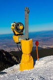 Snow Cannon. A snow cannon or snow gun on a ski slope in Poiana Brasov, Romania royalty free stock image