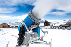 Snow cannon making artificial snow at cold on ski slope Royalty Free Stock Photo