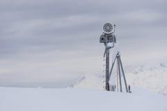 Snow cannon in the mountain ski resort Stock Photo