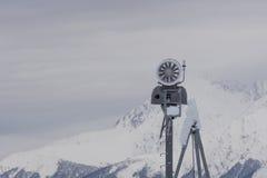Snow cannon in the mountain ski resort Royalty Free Stock Photo