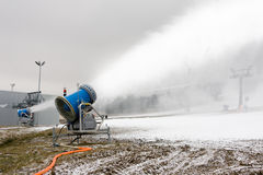 Snow cannon preparing a slope Stock Photography
