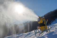 Snow cannon produces artificial snow Royalty Free Stock Image