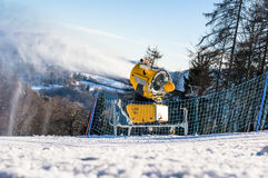 Snow cannon produces artificial snow Stock Photo