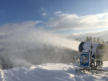 Snow Cannon. Production snow from a snow cannon Royalty Free Stock Photo