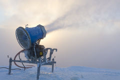 Snow cannon in snow cloud Royalty Free Stock Photos