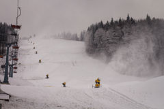 Snow cannons on the slope Royalty Free Stock Photo