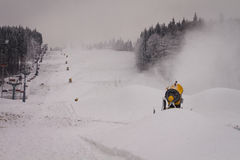 Snow cannons on the slope Royalty Free Stock Photos