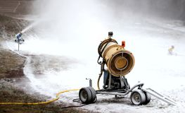 Snow cannons at work on a ski slope Royalty Free Stock Photos