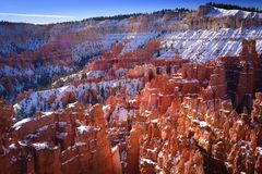Snow caped hoodoos in Bryce canyon. Morning sunlight on snow caped hoodoos of Bryce canyon royalty free stock images