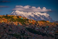 Snow caped mountain. Of Illimani and the city of La Paz at sunset, Bolivia stock image