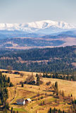 Snow caped mountains in sunny spring day. Beskids mountain range. Woods and meadows in a spring valley stock photography
