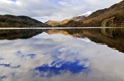 Snow caped Yr Aran and winter coloured snowdonia foothills reflected in Llyn Gwynant. Snow caped Yr Aran and winter coloured snowdonia foothills reflected in the royalty free stock image