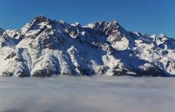 Snow capped Alpine peaks royalty free stock photo