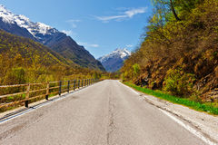Snow-capped Alps. Asphalt Road in Piedmont on the Background of Snow-capped Alps Stock Photography