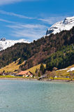 Snow-capped Alps. Lake  on the Background of Snow-capped Alps, Switzerland Stock Image