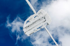 Snow capped chair lift Stock Photos
