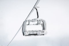 Snow capped chair lift Stock Photography