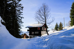 Snow-capped chalet appartment, on Riggi mountain Stock Photography