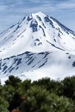 Snow-capped cone of Vilyuchinsky Volcano on Kamchatka Peninsula Stock Photo