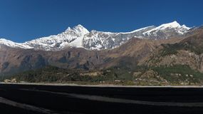 Snow capped Dhaulagiri and Tukuche Peak. View from Sauru, Nepal royalty free stock images