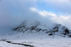 Snow Capped Glen Etive. Gorgeous Epic view of Glen Etive covered in snow and clouds in the Scottish Highlands Stock Photography