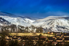 Snow capped hills Stock Images