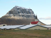 Snow Capped Kirkjufell Mountain seen from the Town of Grundarfjordur, Iceland Stock Photos