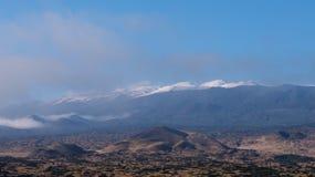 Snow-capped Mauna Kea. Saddle Road offers a nice view at the snow-capped Mauna Kea volcano Stock Photos