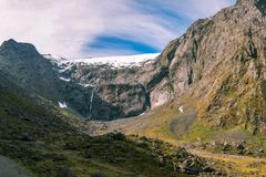 The Snow-capped Mount Talbot in New Zealand. The Snow-capped Mount Talbot on Milford highway close to Homer Tunnel in Fiordland National Park, New Zealand Stock Image