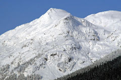 Snow capped mountain. In the winter Stock Images