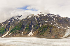 Snow Capped Mountain above an Alpine Glacier Royalty Free Stock Images