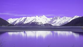 Snow Capped Mountain in Alaska. A Snow Capped Mountain in Alaska at the Turnagain Arm whit a beautiful reflection of the sky stock photography