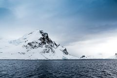 Snow capped mountain in Antarctica.jpg. White, Snow capped mountain in Antarctica in spring Royalty Free Stock Image