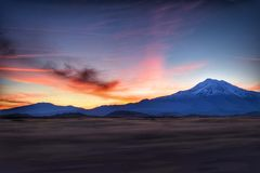 Snow capped mountain with beautiful sunset Stock Images