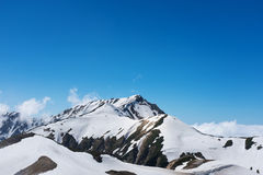 Snow capped mountain landscape. With blue sky Stock Images
