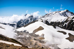 Snow capped mountain landscape. With blue sky Stock Image