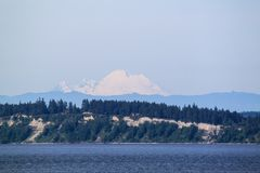 The snow capped mountain of Mt. Rainer royalty free stock photography