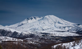 Snow capped mountain peak. Landscape view of a snow capped mountain peak Royalty Free Stock Photos