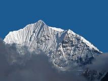 Snow Capped Mountain Peak Stock Photo