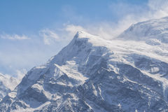 Snow capped mountain peak in the Himalayas Royalty Free Stock Images