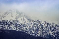 Snow capped mountain peak landscape. Close up image of the snow capped Southern Alps Mountain Range in New Zealand Stock Photography