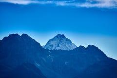 Snow-capped mountain peak. View of the mountain peak. Near the village of Arkhyz royalty free stock photo