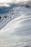 Snow-capped mountain peak Stock Photography