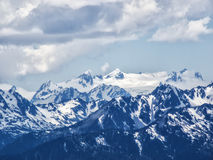 Snow capped mountain peaks Stock Photos