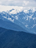Snow capped mountain peaks. Of the Hurricane Ridge in Washington with cloudy skies Royalty Free Stock Photography