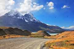 Snow-capped mountain peaks and road Stock Photos