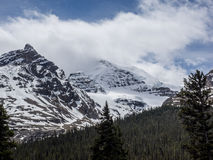 Snow capped mountain peaks with storm clouds Royalty Free Stock Images