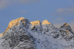 Snow-capped mountain peaks Stock Photography